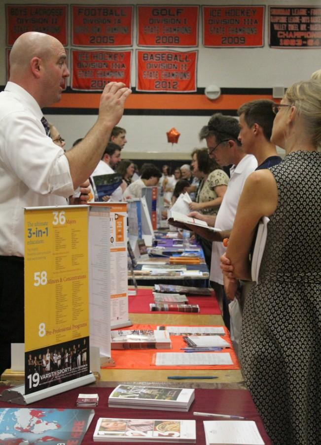 College+representatives+lined+up+to+receive+questions+from+students+and+families+from+western+Mass