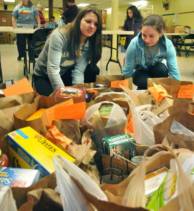 students from South Hadley High School come together to collect food items .