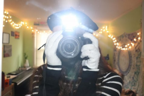 Artistic Expression: A photographer plays around with mirrors.